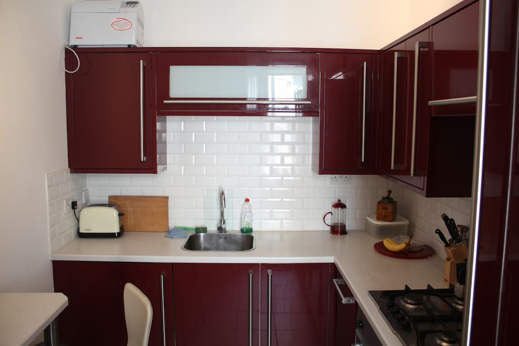 The kitchen, including a built-in washing machine & dryer, dishwasher, fridge and freezer, oven and small breakfast table