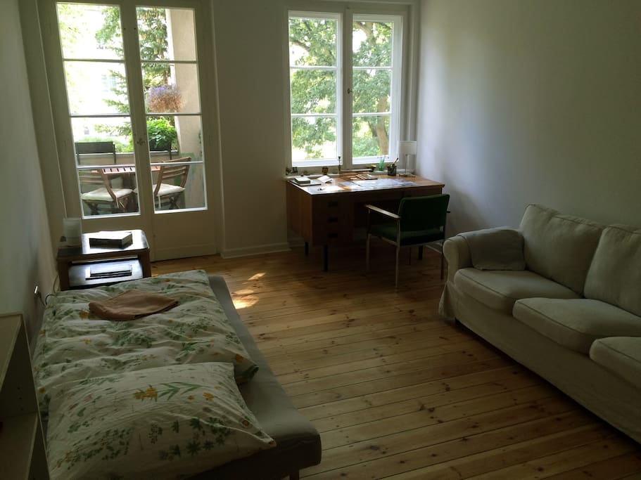 Large, bright living room with a fold out sofa bed (pictured already folded down) and an additional, comfortable sofa, plus a balcony for nice morning sunny breakfasts, facing southeast.