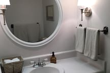 A full private bathroom is yours to enjoy with a brand new washer and dryer attached.