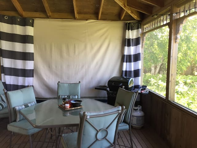 Our screened in back porch is a favourite among our guests! Here you will find a BBQ for your use, dining area as well as our large hot tub! If you are travelling with children the back porch is the place to be after the kids are in bed!
