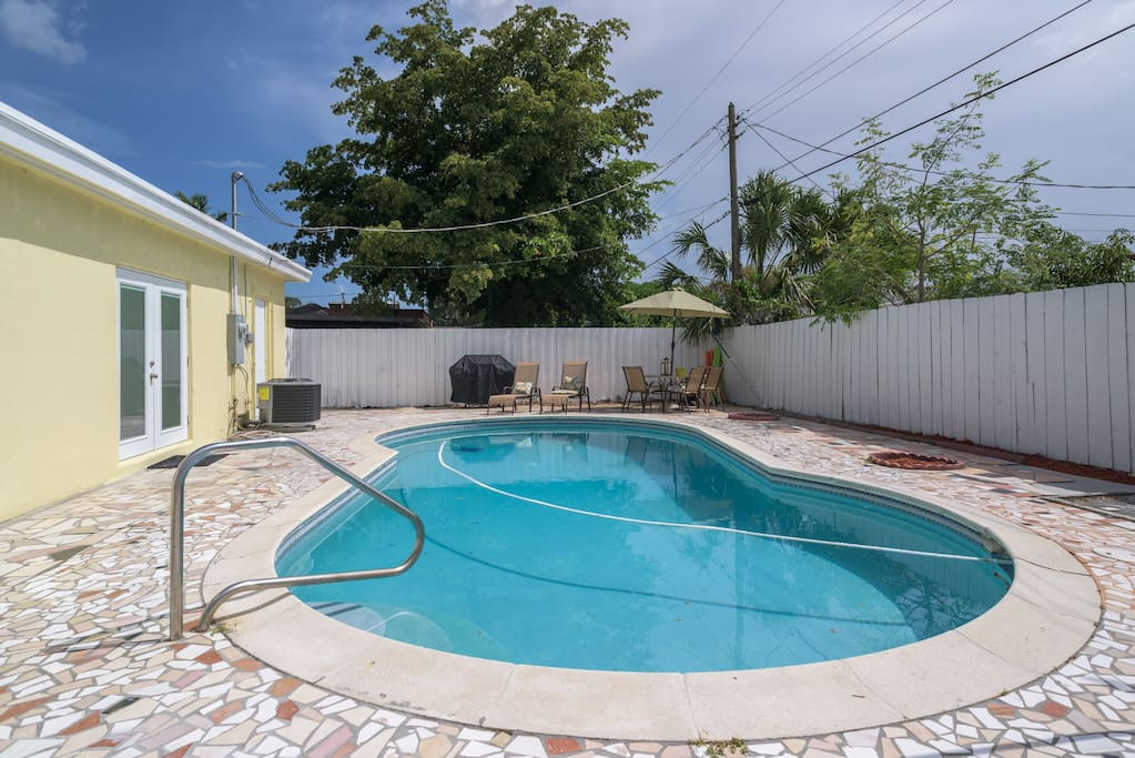 Large pool area , pergola included and lots of pool accessories and toys!