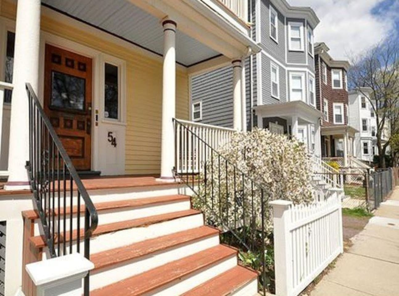 The home is located in a quiet residential neighborhood with easy train access to downtown Boston.