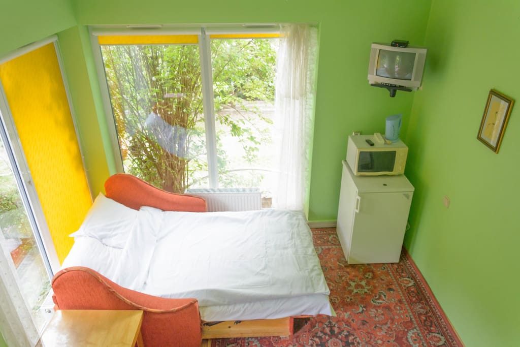 Room for up to 4 persons with two wide double sofa-beds, TV, table, chair, cupboard.