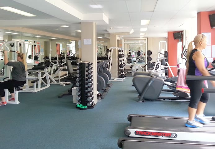 The gym and day spa are located on the first floor.  It is owned by an external operator on a user pays basis.