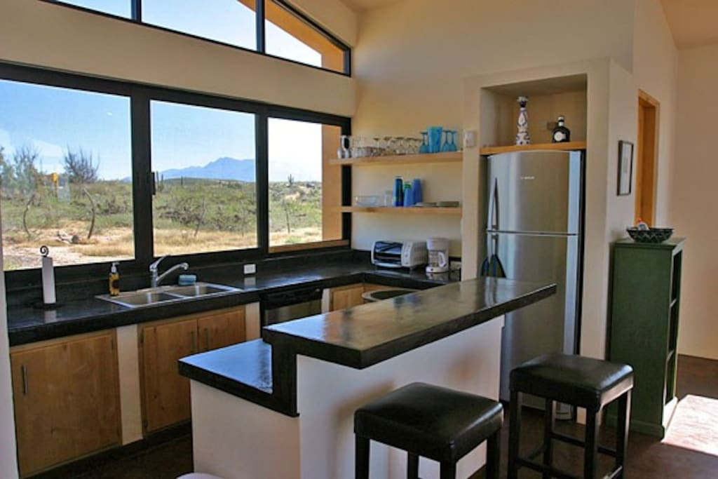 Kitchen with view to desert landscape and mountains of Baja.