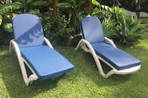 Chaise loungers for relaxing.