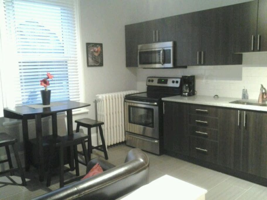 Access to cook all you need are your ingredients... Grocery store down the street. Fully equipped kitchen, granite counter top, BRAND NEW appliances including 2 fridge, dishwasher, toaster oven, coffee maker, dishes, cutlery, pots & pans.