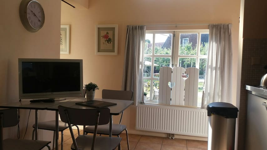 Living-room with DVD/ TV and diner table.