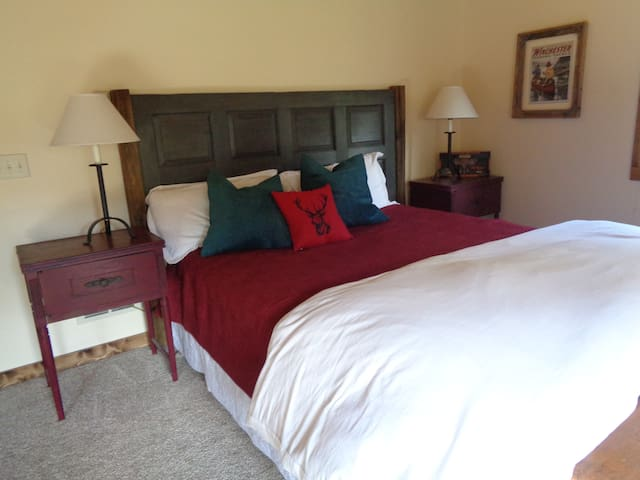 This comfy Cal/King bed is right next to the window above the creek.