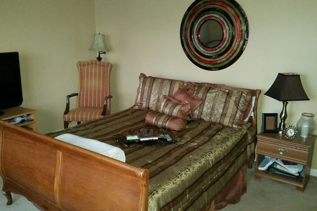 Queen size bedroom with dresser.  Room has cable television and Wi-Fi.  Room is upstairs and utilizes a shared bathroom.