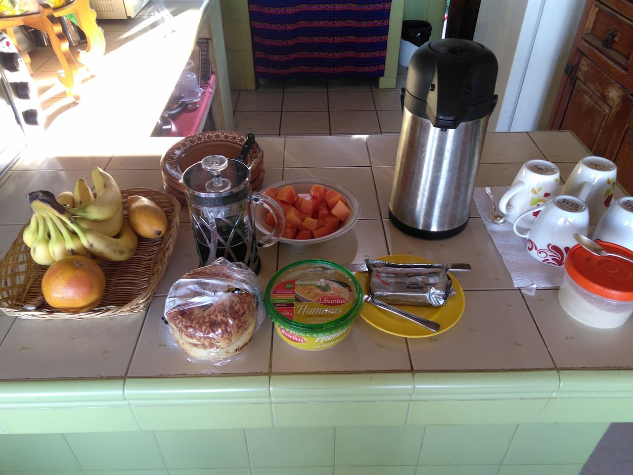Fruit, coffee, toast or bagels, cream cheese for breakfast
