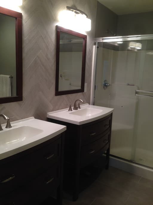 Master bathroom with dual vanities and roomy shower.
