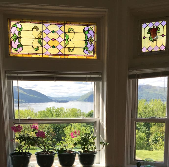 Riversong morning view from the 2nd floor bedroom with original, Victorian era stained glass.