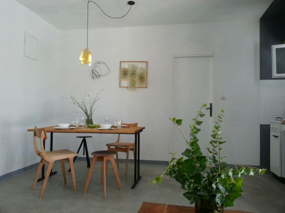 Dining space view... natural wood protection with oils and resins, vintage chair forms,  designed, beautiful lights, industrial floor, nice, creative details...