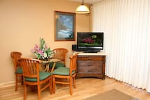 """Living room with 42"""" smart TV flatscreen. Watch your favorite Netflix or You Tube videos."""