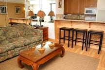 Raised granite bar great for having meals and watching the cooking.