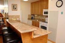 Fully stocked kitchen with flat stove top. We believe in having all the amenities that we have at home. Enjoy!
