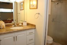 Bathroom has blow dryer, iron with ironing board and in-suite washer and dryer. Bathroom vanity is separate from the shower and the bedroom which can be entirely closed off.