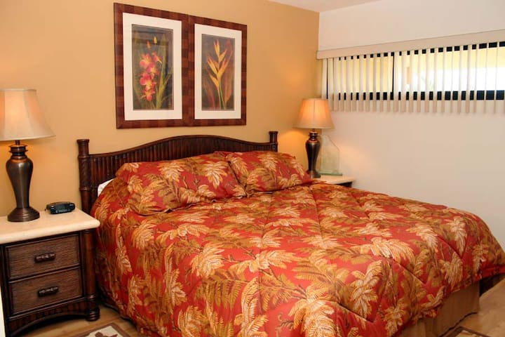 King size bed with ceiling fan.