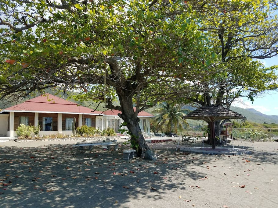 Villa facing the sea. Beautiful almond trees provide ample shade in the seaside/back garden, with sand at your feet!  The gazebo has been the site of many a wedding.