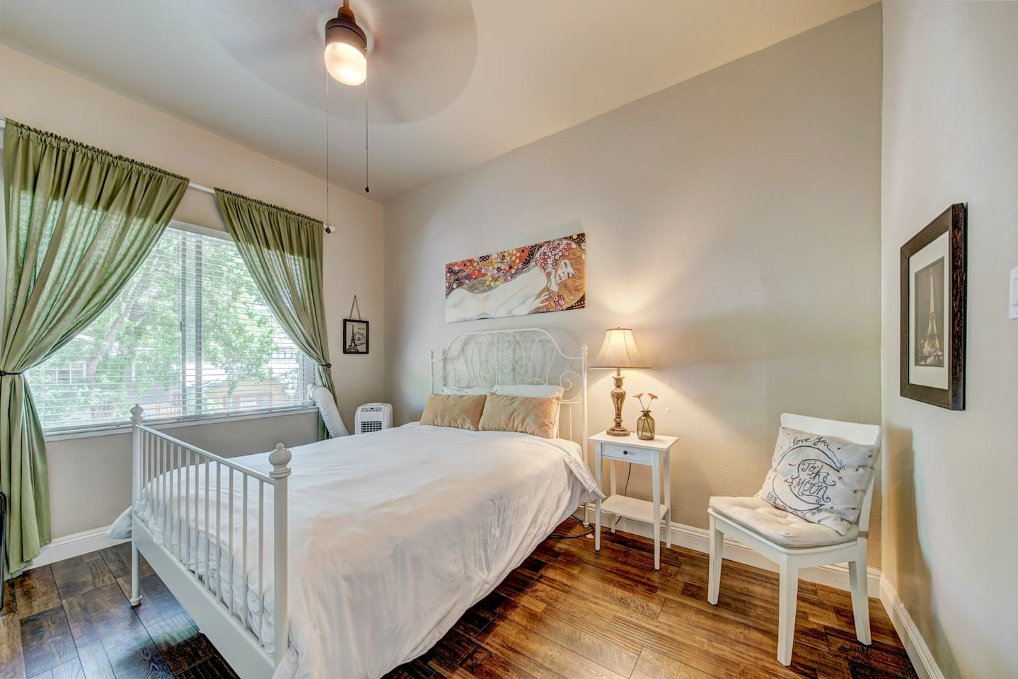 Spacious front bedroom with plenty of room for your belongings and natural light that streams in through he massive trees that line the street outside