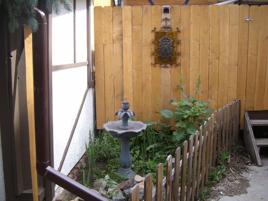 Entry garden with small fountain just inside the gate.
