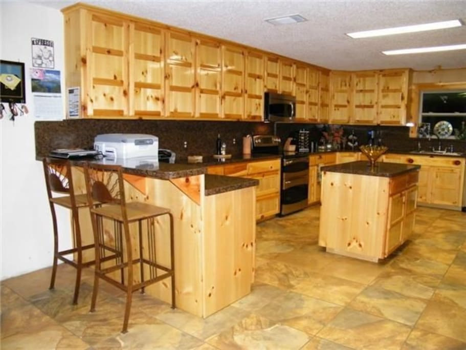 Huge Kitchen with double oven, microwave, coffeemaker, dishwasher and large refrigerator.