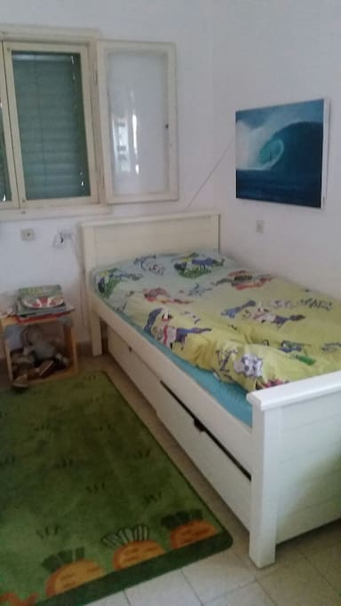 chidren room their are two beds and another openning bed