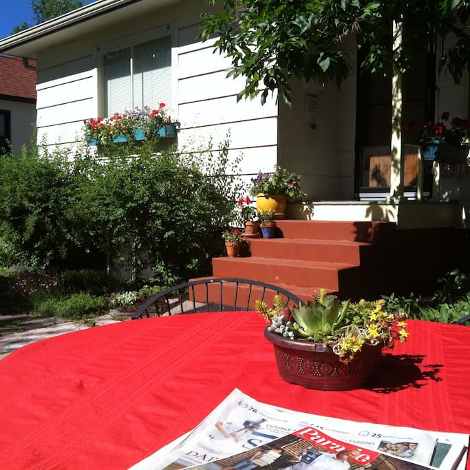 Round table in the front garden is a great place to relax anytime of day.