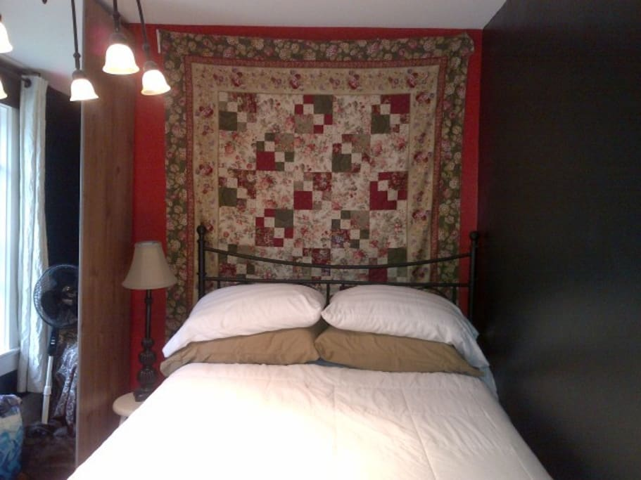The Abby has a comfy double bed with a large wardrobe and an armchair.