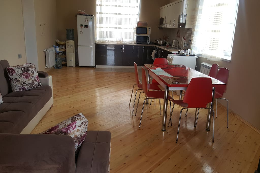 Kitchen includes microwave, refrigerator, tv, air conditioner and furniture.