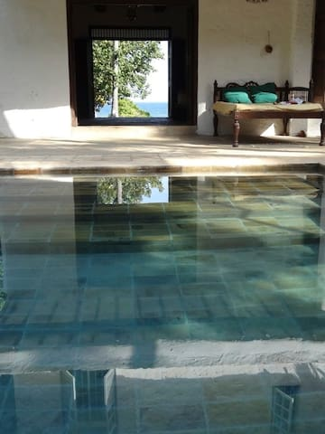 View from the pool through the sitting room