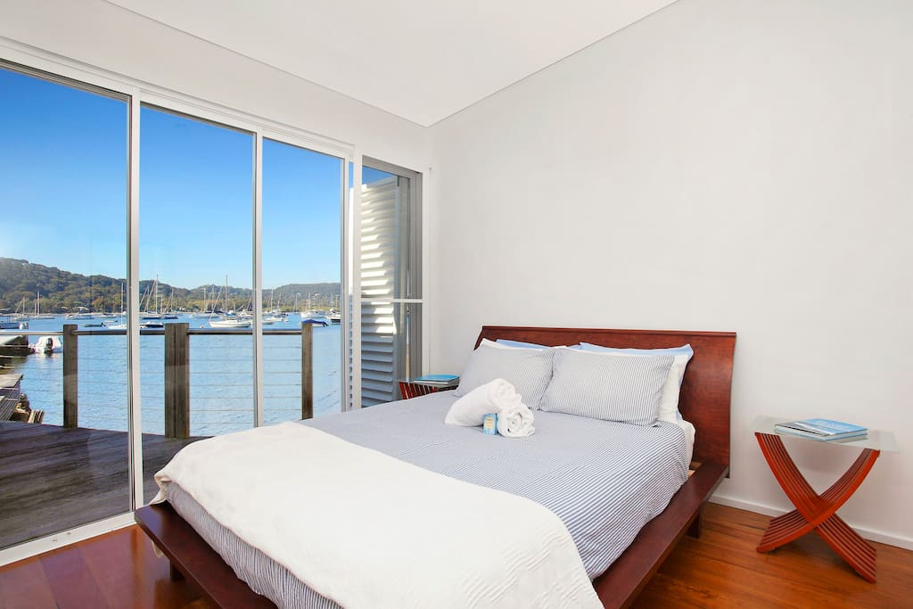 Master bedroom with unobscured views of the water