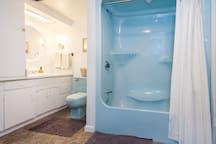 The bathroom has personality, though not as posh as some other listings. We love her, though. The washer and dryer reside in this room in a too small of closet, ha!