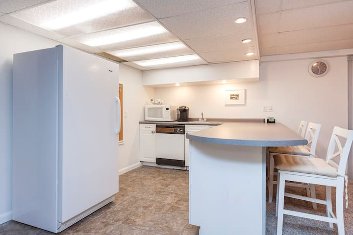 The kitchen has a dishwasher, a fridge , microwave, coffee maker, all dish ware, a countertop cooking plate (there's no oven or stove), and maybe some other fun things we'll add as it seems intriguing.