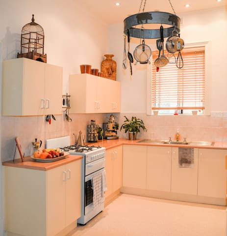 Kitchen with everything you need, including oven, stove, microwave and fridge. If you are wanting to prepare your own meals, there are plenty of pots, pans and utensils. There are also storage containers, coffee machine, plunges, toasters & kettle.