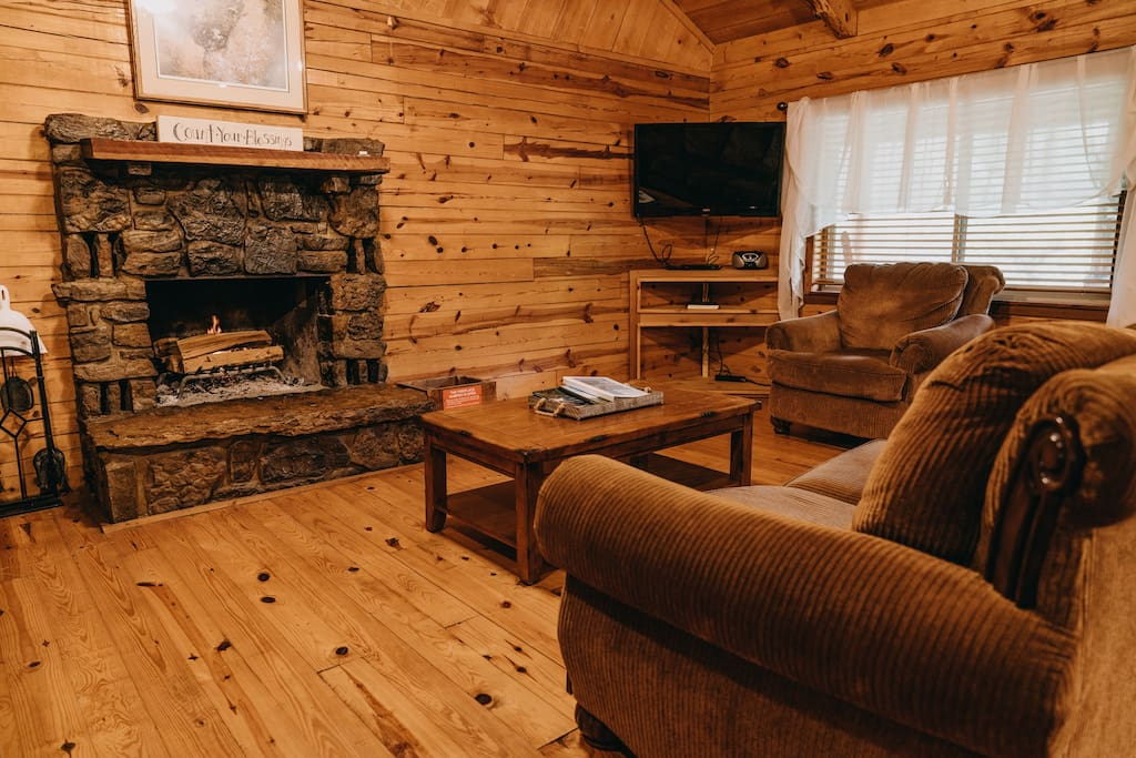 The cabin's cozy living area with fireplace.