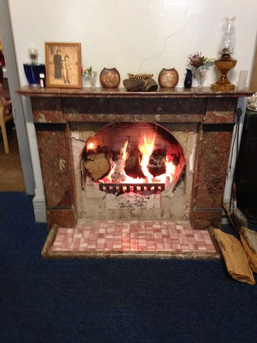 One of three warm and cosy fireplaces located in living areas