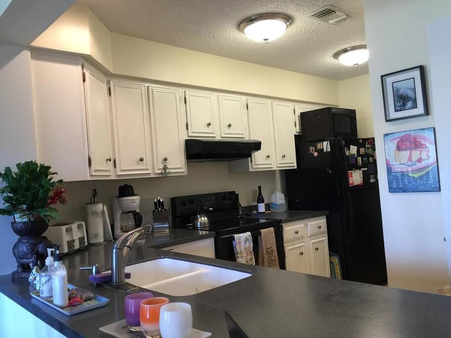 Updated kitchen with modern appliances.