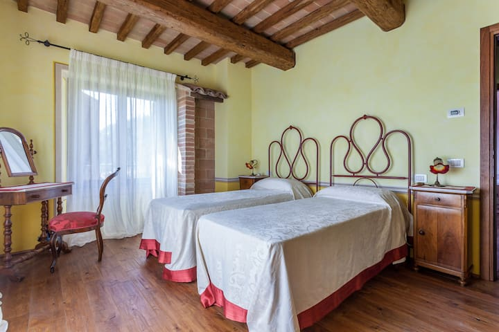Yellow bedroom of the villa with pool