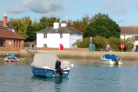 18th century cottage with stunning harbour views