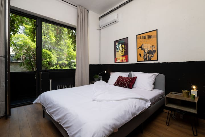 Second Bedroom with private balcony and a closet