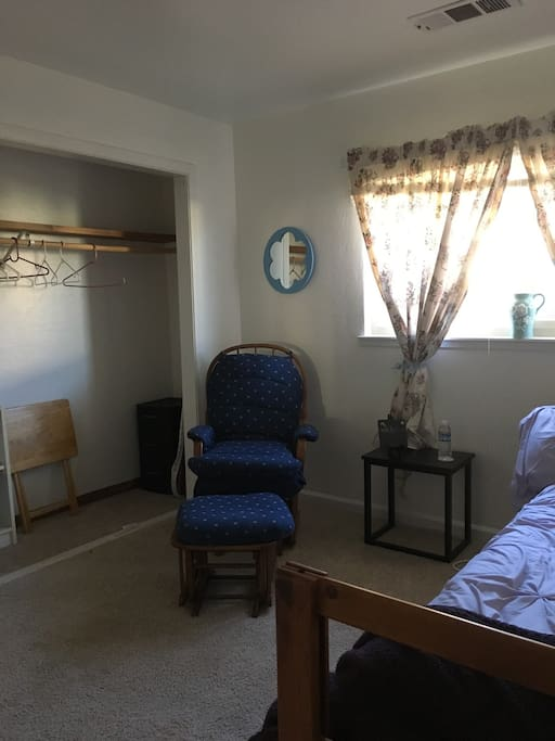 Rocking chair, ottoman, end table and folding TV tray available (in closet) for laptop