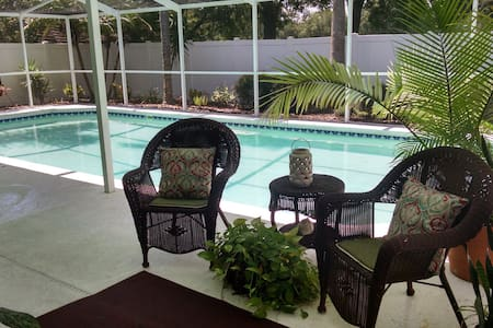 Spacious home with 35 Foot Pool & Patio on park.