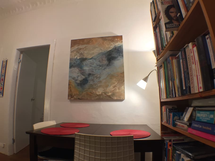 Painting 'The Lagoon' by Australian artist Warwick Baird above dining table