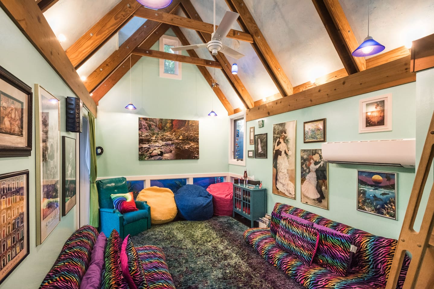 This is your space. Two comfortable futons on the floor.  One in the loft.  Bean bags abound.