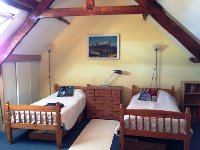 People love this large beamed room at the top of the house, which sleeps 2-4 guests, in twin beds and a sofa/bed with pull-out underneath.