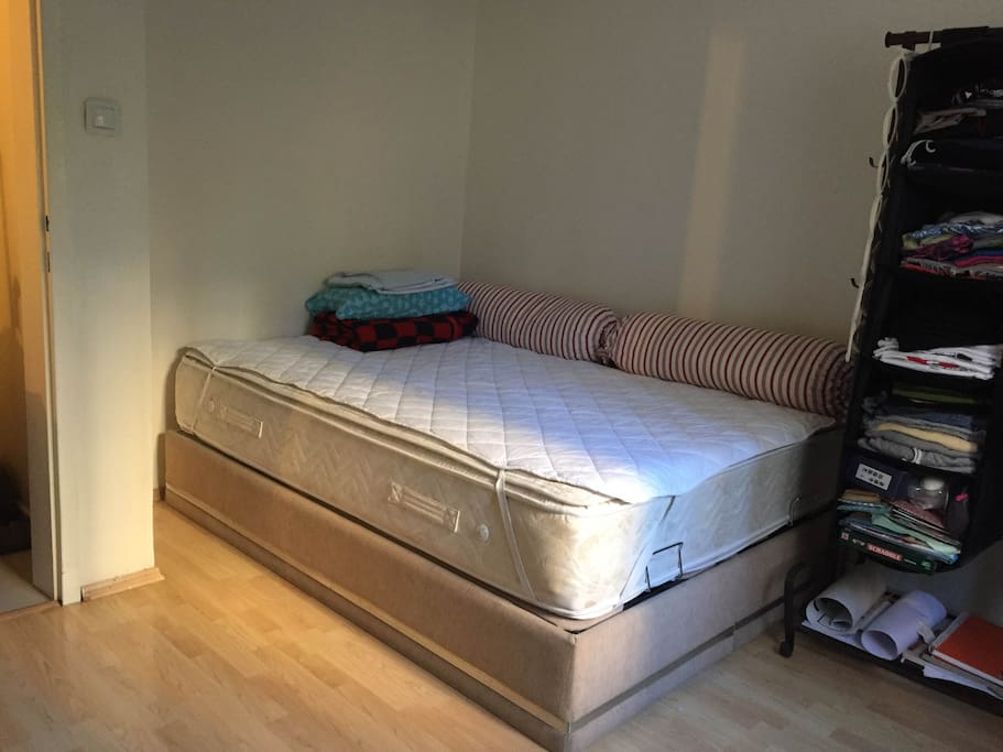 The rented room has double bed and open wardrobe.