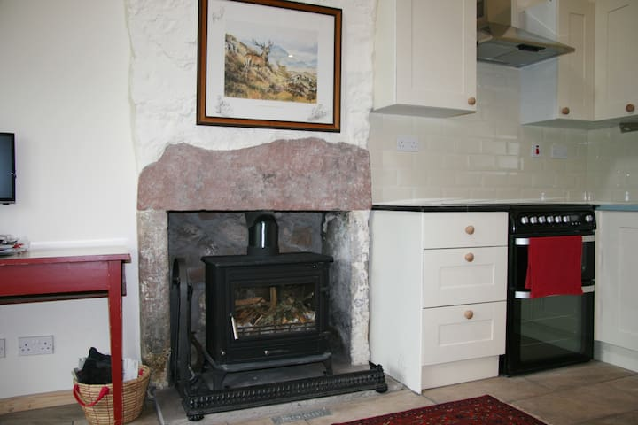 A cosy log burner gives the cottage a friendly and romantic atmosphere