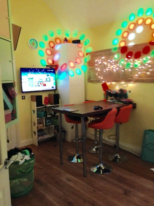 Playroom ( kids and Adults) with TV, Xbox, Table and stools. Surround sound Amp Disco ball and lights.